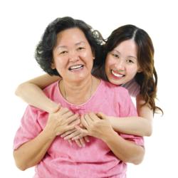 caregiver hugging patient
