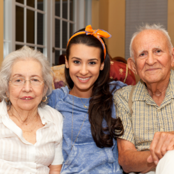 caregiver with two elderly patients