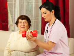 nurse assisting patient to exercise